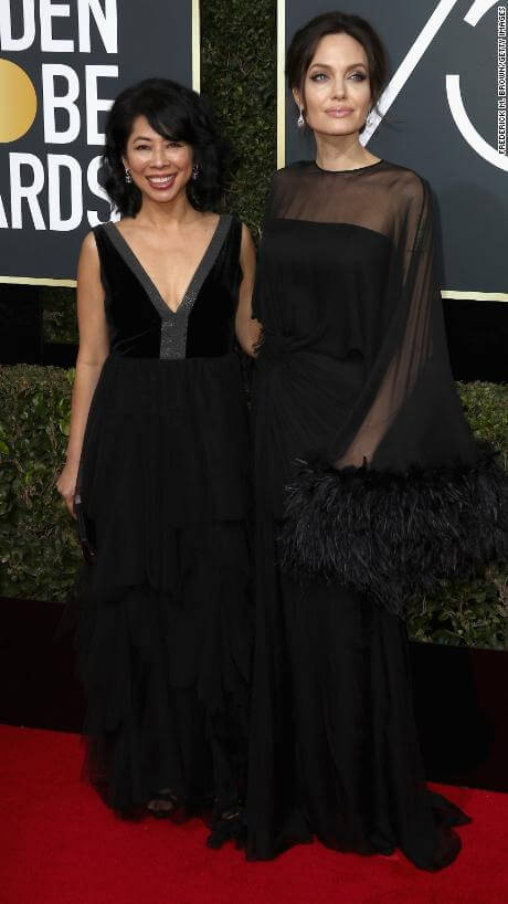 BEVERLY HILLS, CA - JANUARY 07: Loung Ung and Angelina Jolie attends The 75th Annual Golden Globe Awards at The Beverly Hilton Hotel on January 7, 2018 in Beverly Hills, California. (Photo by Frederick M. Brown/Getty Images)