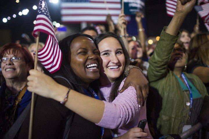 Supporters of U.S. President Barack Obama celebrate his victory in the presidential election at his election night rally in Chicago.