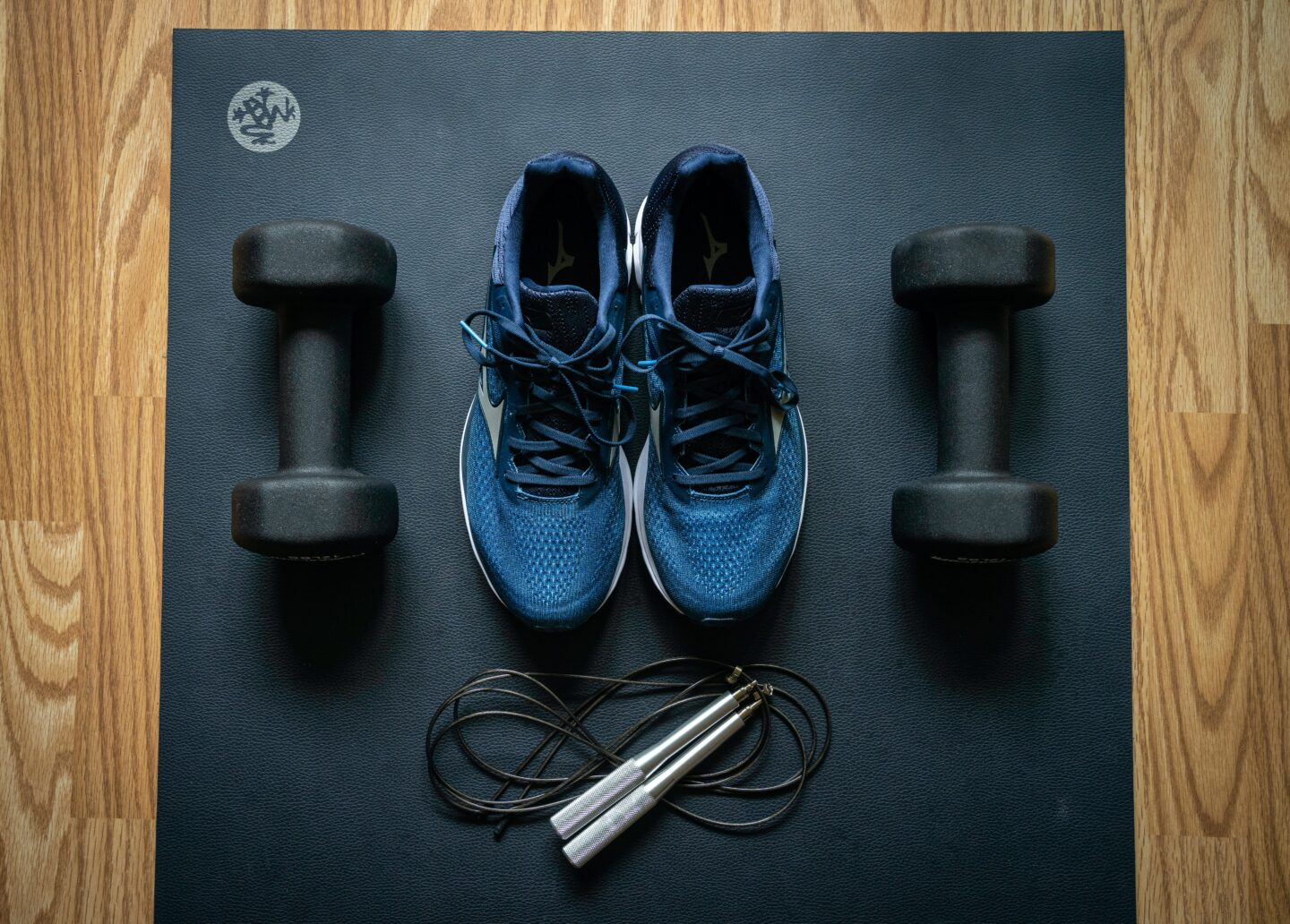 free weights, sneakers and jump rope