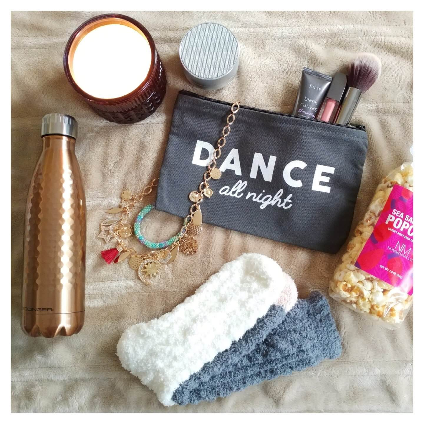 stay-warm-this-winter-cozy-socks-scented-candles-popcorn