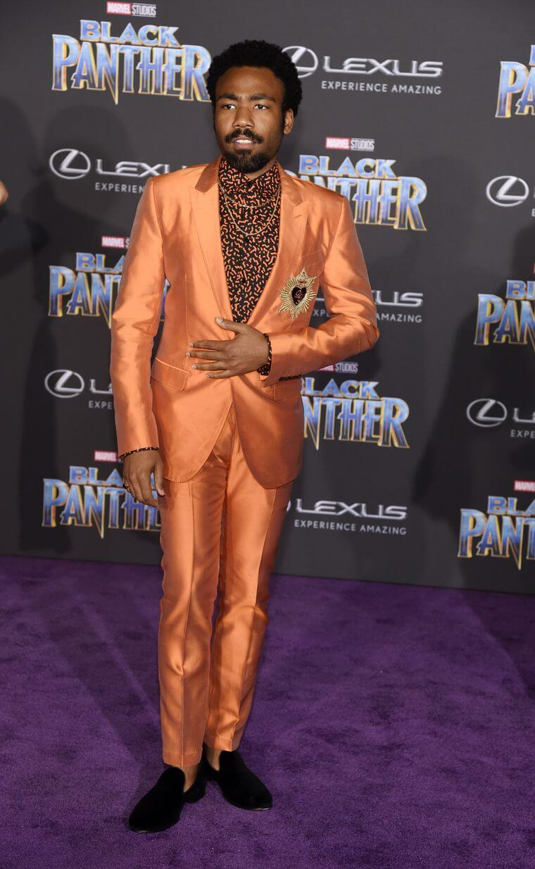 Donald Glover wears orange on Black Panther red carpet