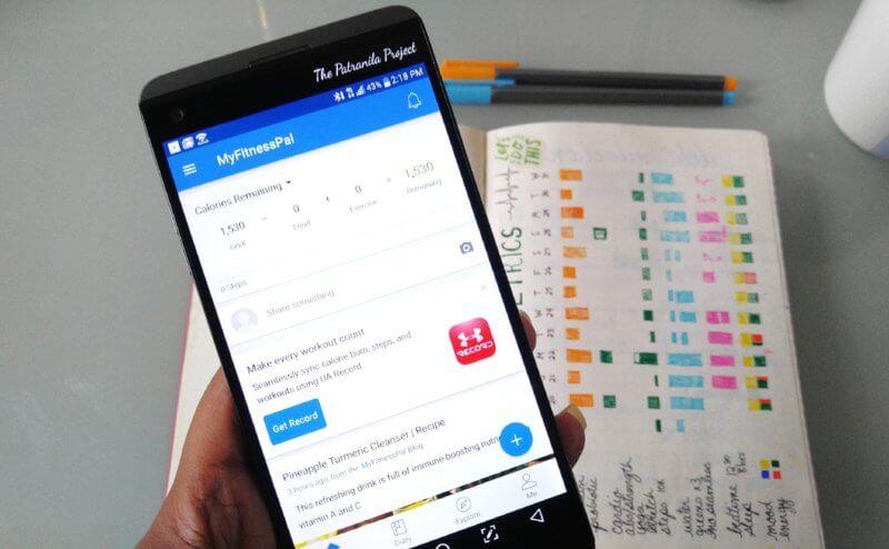Patranila holds cell phone with MyFitnessPal app