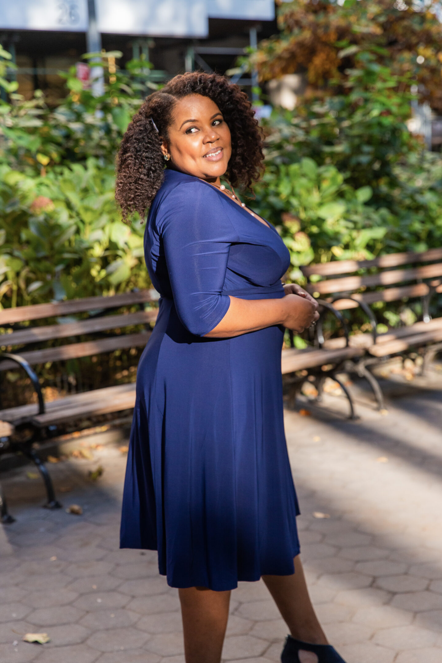 patranila wears kiyonna essential wrap dress in nouveau navy